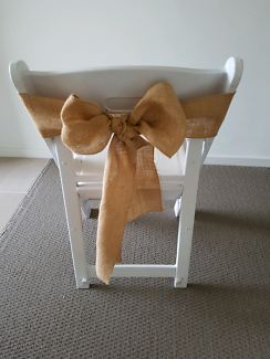 20 white wooden folding chairs