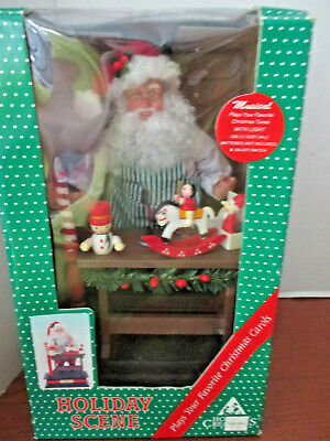 Home Creations~LIGHTED MUSICAL Animated SANTA CLAUS in TOY SHOP~NOEL~New In Box ()