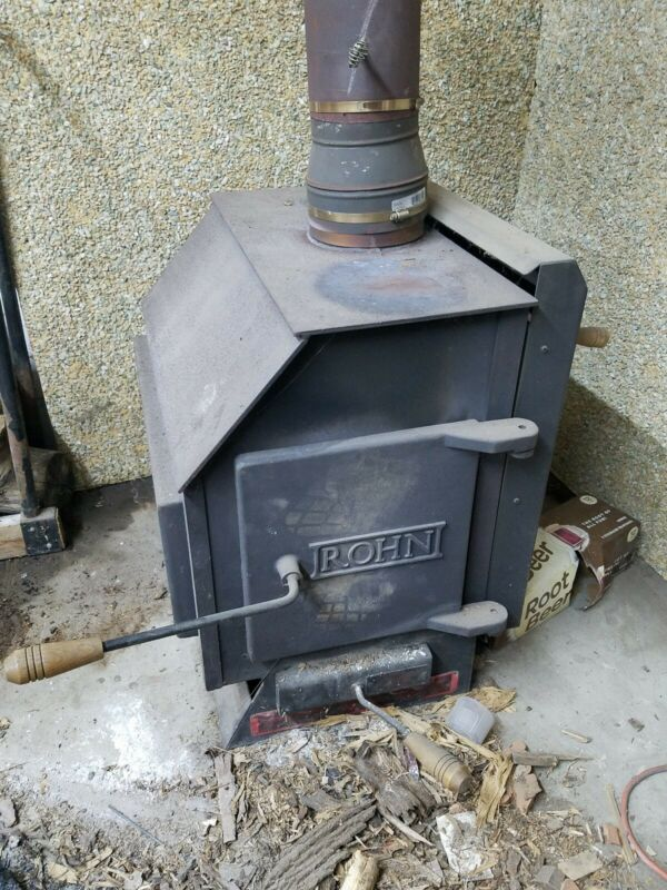 Vintage ROHN wood Burning Stove with pipe and flue blower (summitville in )