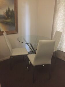 Glass Dining Table and 3 white chairs