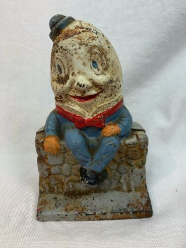 Antique Humpty Dumpty Cast Iron Bank in Great Condition. Measures 5 1/2 c869