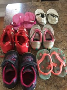 Six pairs of size 5-6 shoes for toddler girls .