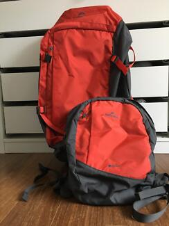 Near new Kathmandu red/grey 70l backpack and compatible daypack