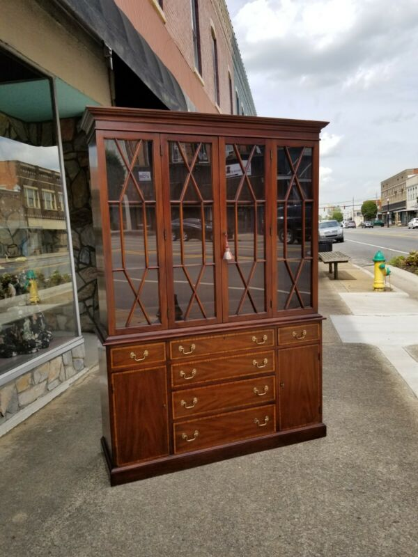 Grand Flamed Mahogany China Cabinet crafted by Henkel Harris 20thc
