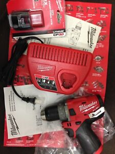 Milwaukee M12 hammer drill, battery and charger.