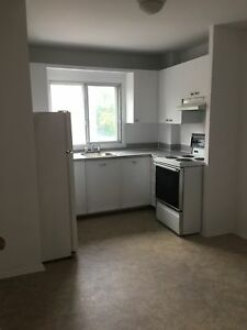 DORVAL-  4 1/2  unheated, fridge & stove included