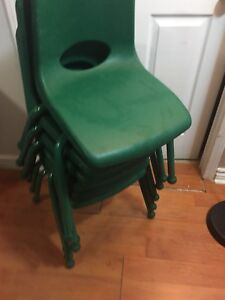 6 green daycare/ child chairs