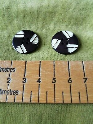A PAIR OF VINTAGE SHAPED MEDIUM ART DECO BLACK & WHITE ROUND BUTTONS