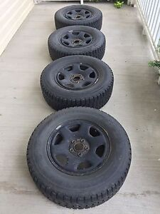 Set of 235/70R16 Firestone Winterforce tires on black rims