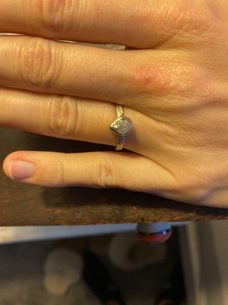 Raw diamond in 14k white gold ring. 1.25 carat size 6.