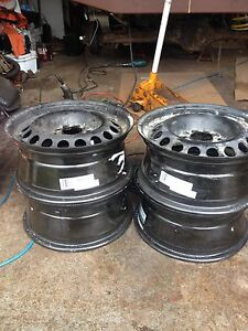 4 15 inch steel rims in new condition