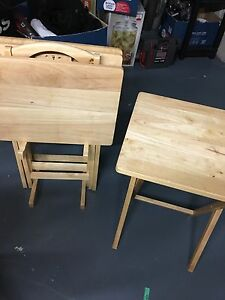A set of four serving tables