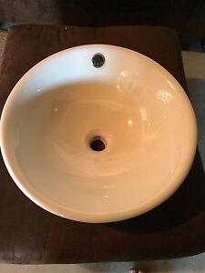 Brand new white vessel sink with new faucets