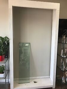 White shelving unit with glass shelves