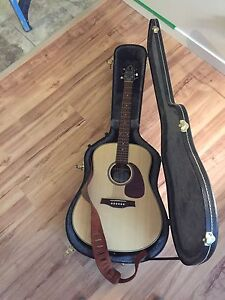 Seagull guitar with leather case.. excellent condition