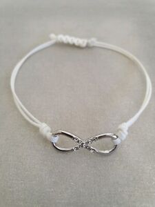 Delicate infinity silver and leather bracelet