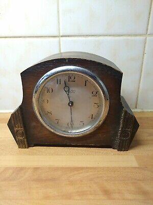 TYMO Wooden Mantle clock 13cm high x 18cm x 7cm deep approx.Spare or repair