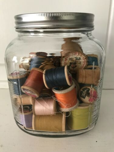 Lot of 41 Wood Spools of Thread In Glass Jar with VINTAGE WOOD THIMBLE
