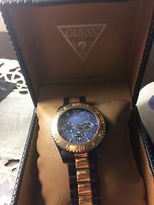Men's rose gold Guess watch