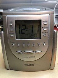 Timex T-309T Alarm Clock Radio with Nature Sounds ,Buzzer and Radio alarm.