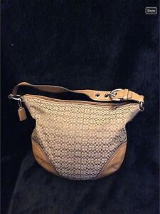 Authentic COACH purse with leather camel color