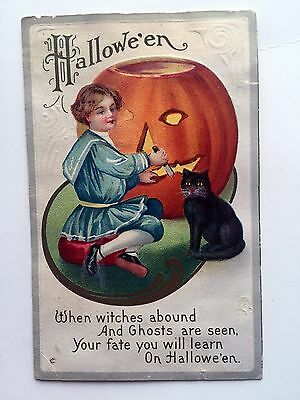 Vintage Halloween Postcard Girl Carving Pumpkin w/ Black cat