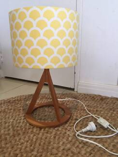 modern tripod table lamp with yellow lampshade