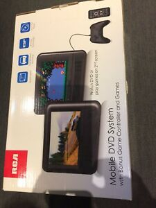 RCA mobile DVD system - bonus game controller/games - brand new
