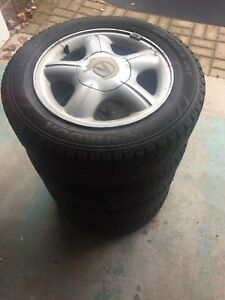 Snow tires (Hankook) with rims (Acura)