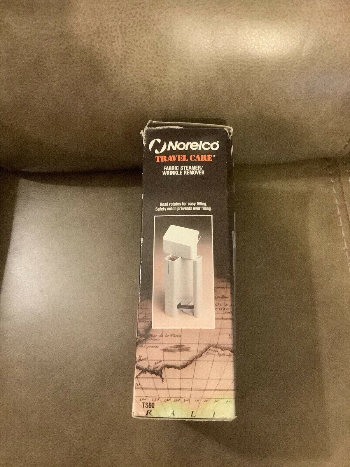 NORELCO TRAVEL CARE FABRIC STEAMER/WRINKLE REMOVER - $3.99