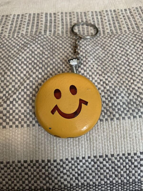 Smiley Face Lighter. Round With Keychain. Yellow