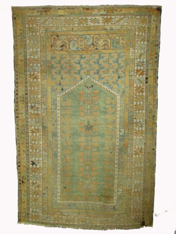 A 19th Century Prayer Rug with Muted Tones