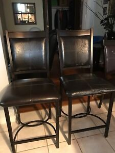 2 brown barstools from Bowring .