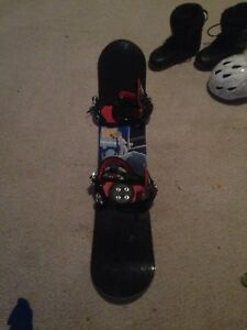 Snowboard with boots and helmat