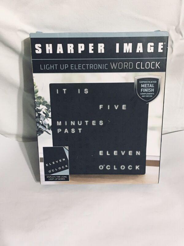 Sharper Image Light Up Electronic Word Clock Matte Black Finish with LED Lights