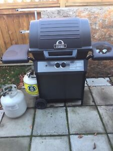 Broil-mate BBQ and 2 propane tanks.