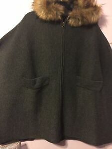 Brand new poncho style coat with fur around hood