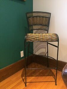 Three tall wicker and metal bar chairs