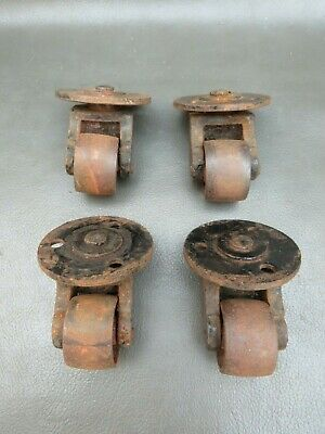 Set of 4 vintage cast iron castors - furniture restoration parts
