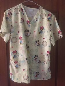 Two scrub tops in excellent condition size large