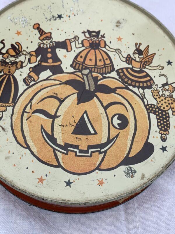 VINTAGE Antique US METAL HALLOWEEN TAMBOURINE NOISEMAKER--WINKING PUMPKIN RARE
