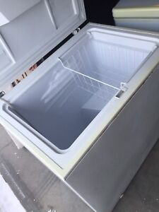 Has lock bigger freezer works perfectly