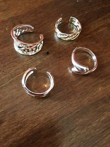 Set of four 925 silver adjustable rings