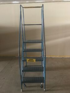 Used  4 step rolling safety  steel warehouse ladder