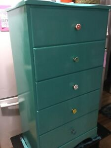 Green / blue tall dresser with flower handles.