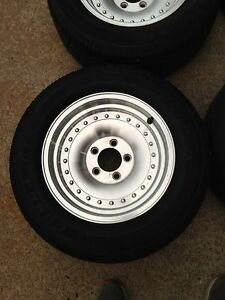 4 15x7 centerline style rims with tires