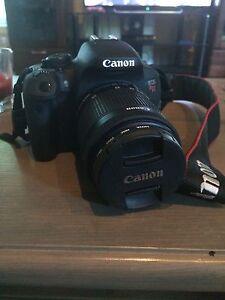 Black Canon EOS Rebel T5i camera