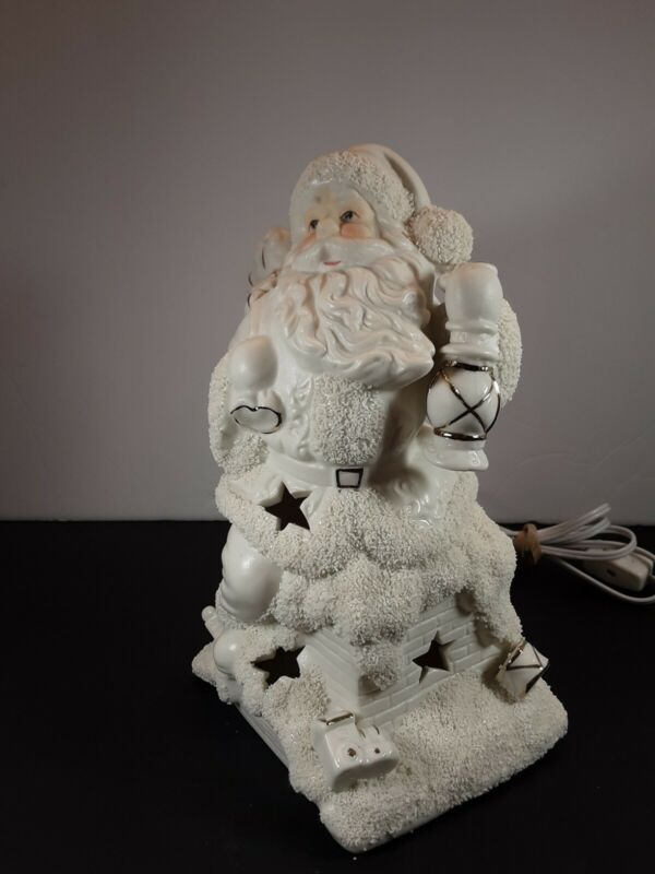 Ceramic lighted White  Santa on a chimney with gold accents