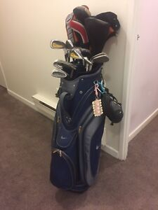 Nike golf bag with tons of golf clubs