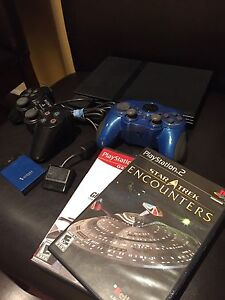 PlayStation - PS2 with 2 controllers and 2 games